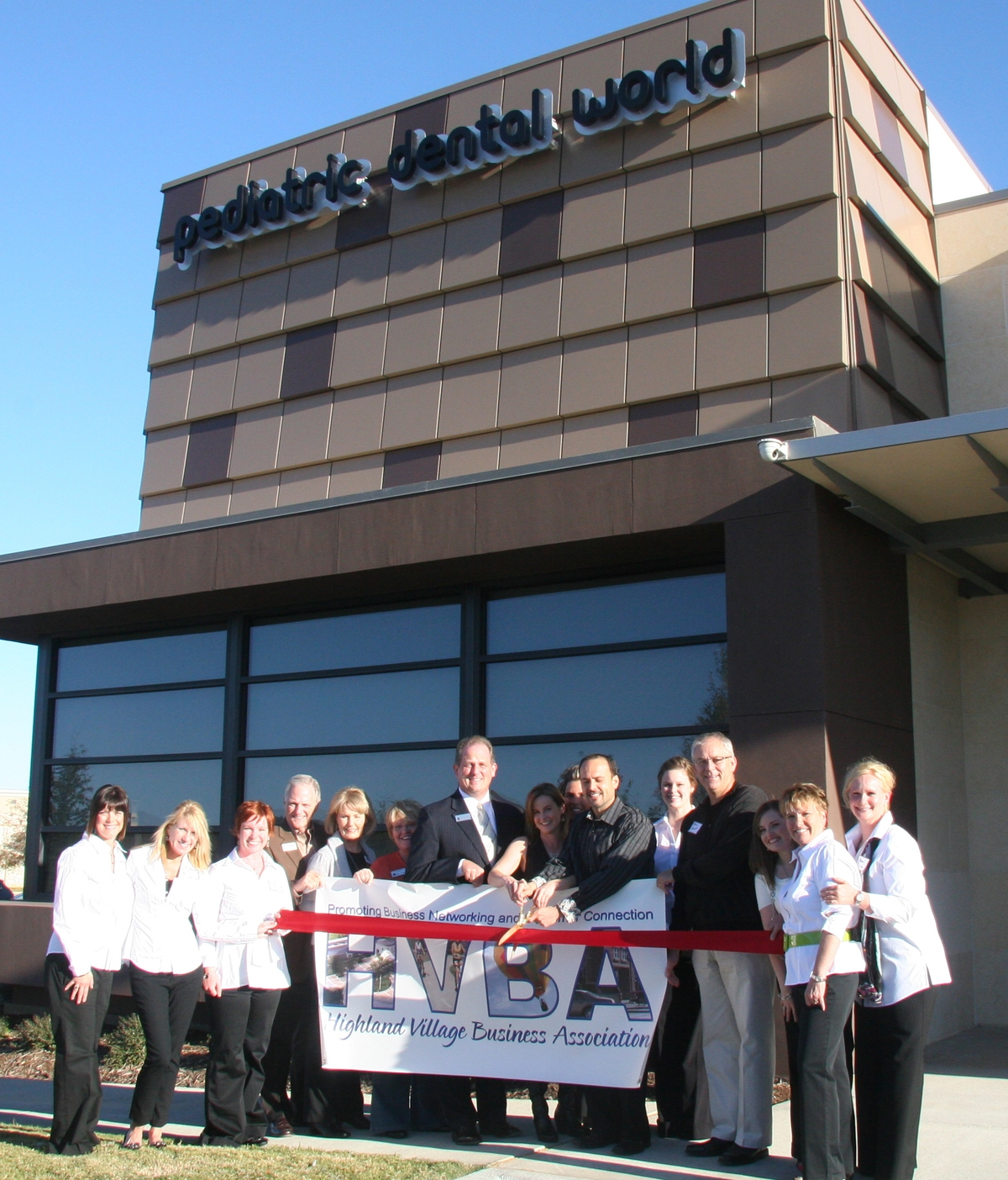 ribbon cutting - Pediatric Dental World