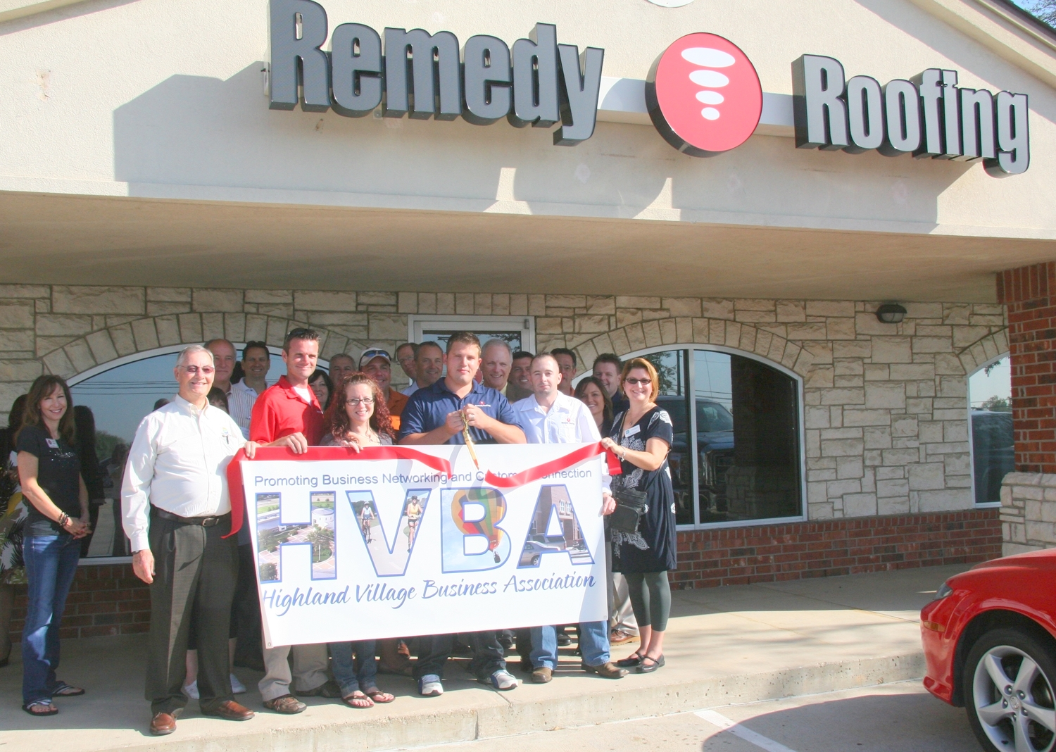 ribbon cutting - Remedy Roofing